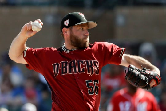 Arizona Diamondbacks relief pitcher Greg Holland throws against the Cincinnati Reds during the fourth inning of a spring baseball game in Scottsdale, Ariz., Monday, March 4, 2019. (AP Photo/Chris Carlson)