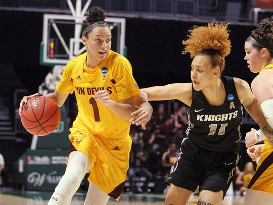 UCF guard Kayla Thigpen (11) defends Arizona State guard Reili Richardson (1), during a first round women's college basketball game in the NCAA Tournament in Friday, March 22, 2019, in Coral Gables, Fla. (AP Photo/Luis M. Alvarez)