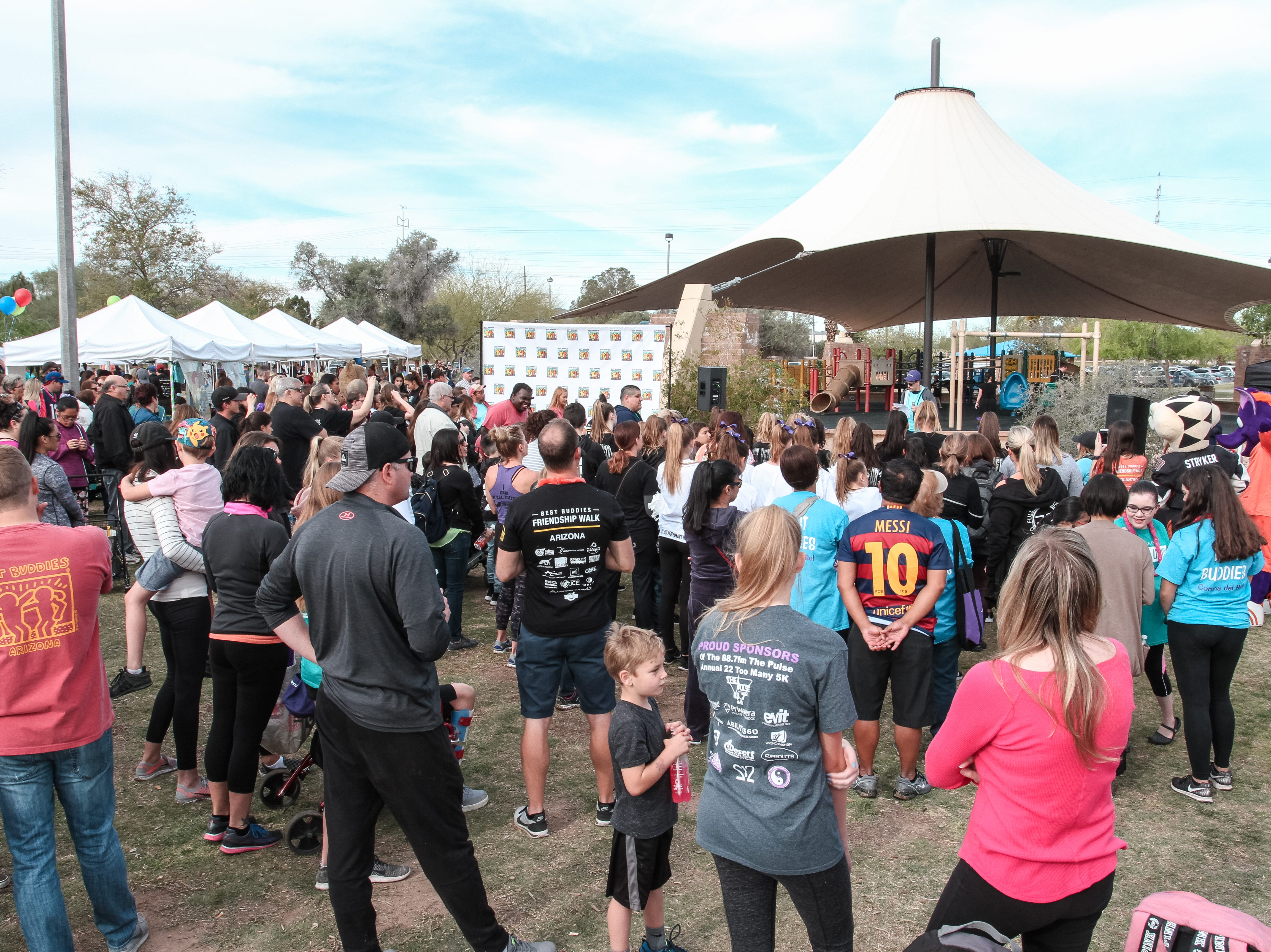 Participants wait to begin walking at The Best Buddies Friendship Walk at Kiwanis Park in Tempe on March 23, 2019.