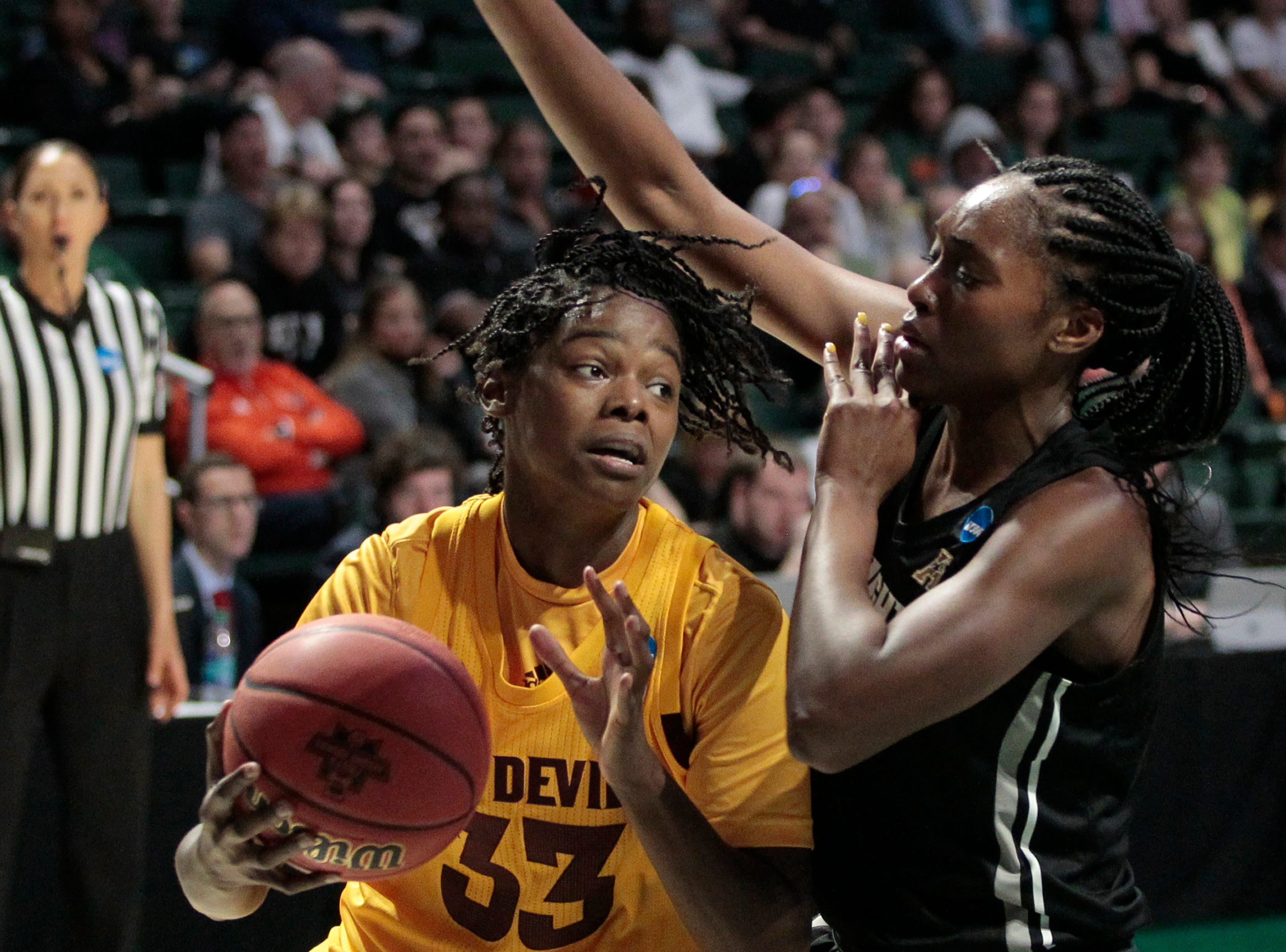Arizona State center Charnea Johnson-Chapman (33) drives to the basket around UCF forward Masseny Kaba (5), during a first round women's college basketball game in the NCAA Tournament in Friday, March 22, 2019, in Coral Gables, Fla. Arizona State defeated UCF 60-45. (AP Photo/Luis M. Alvarez)