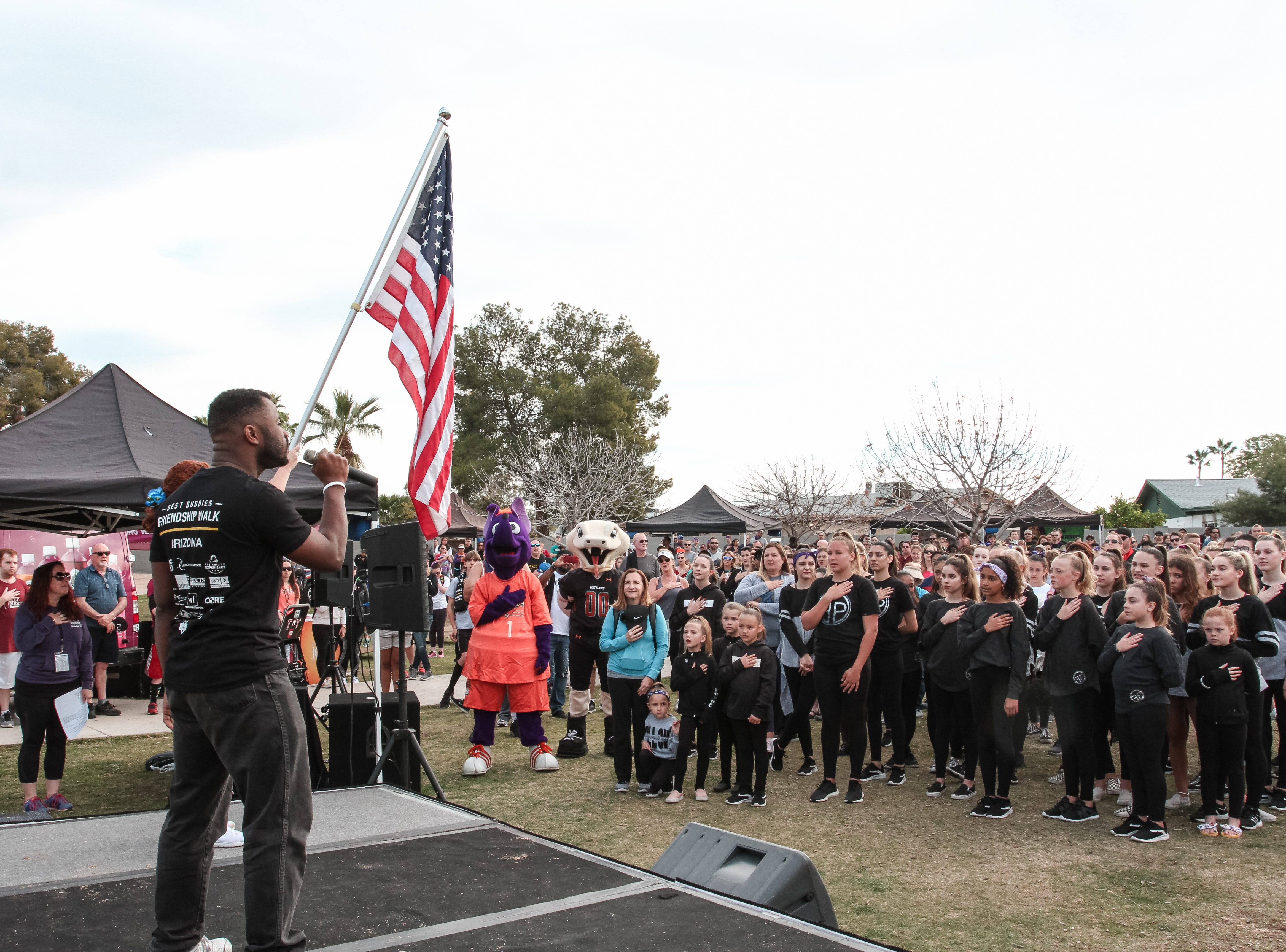 Justin Toler sings the National Anthem at The Best Buddies Friendship Walk at Kiwanis Park in Tempe on March 23, 2019.