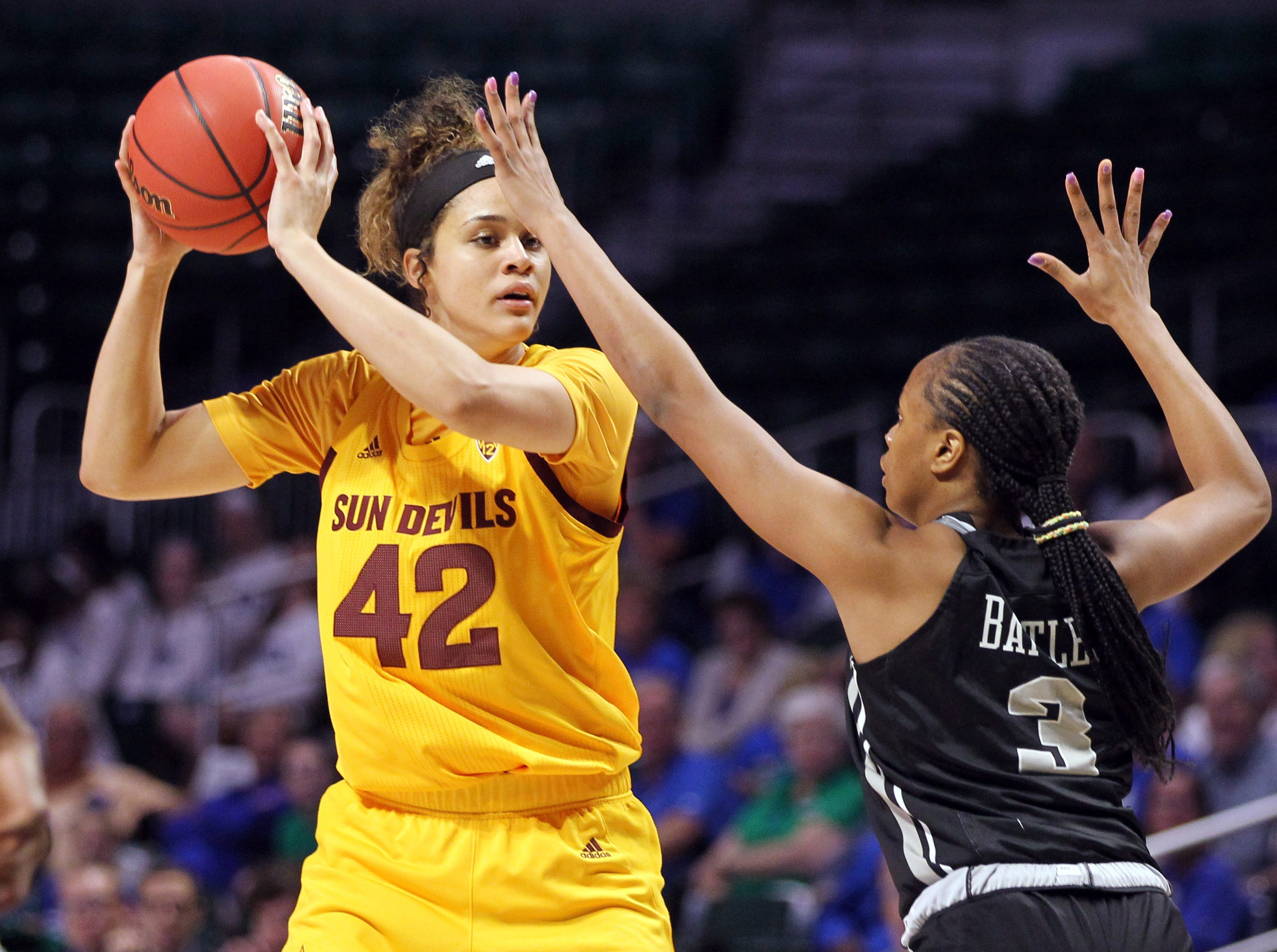 Arizona State forward Kianna Ibis (42) looks to pass asUCF guard Diamond Battles (3) defends, during a first round women's college basketball game in the NCAA Tournament in Friday, March 22, 2019, in Coral Gables, Fla. (AP Photo/Luis M. Alvarez)