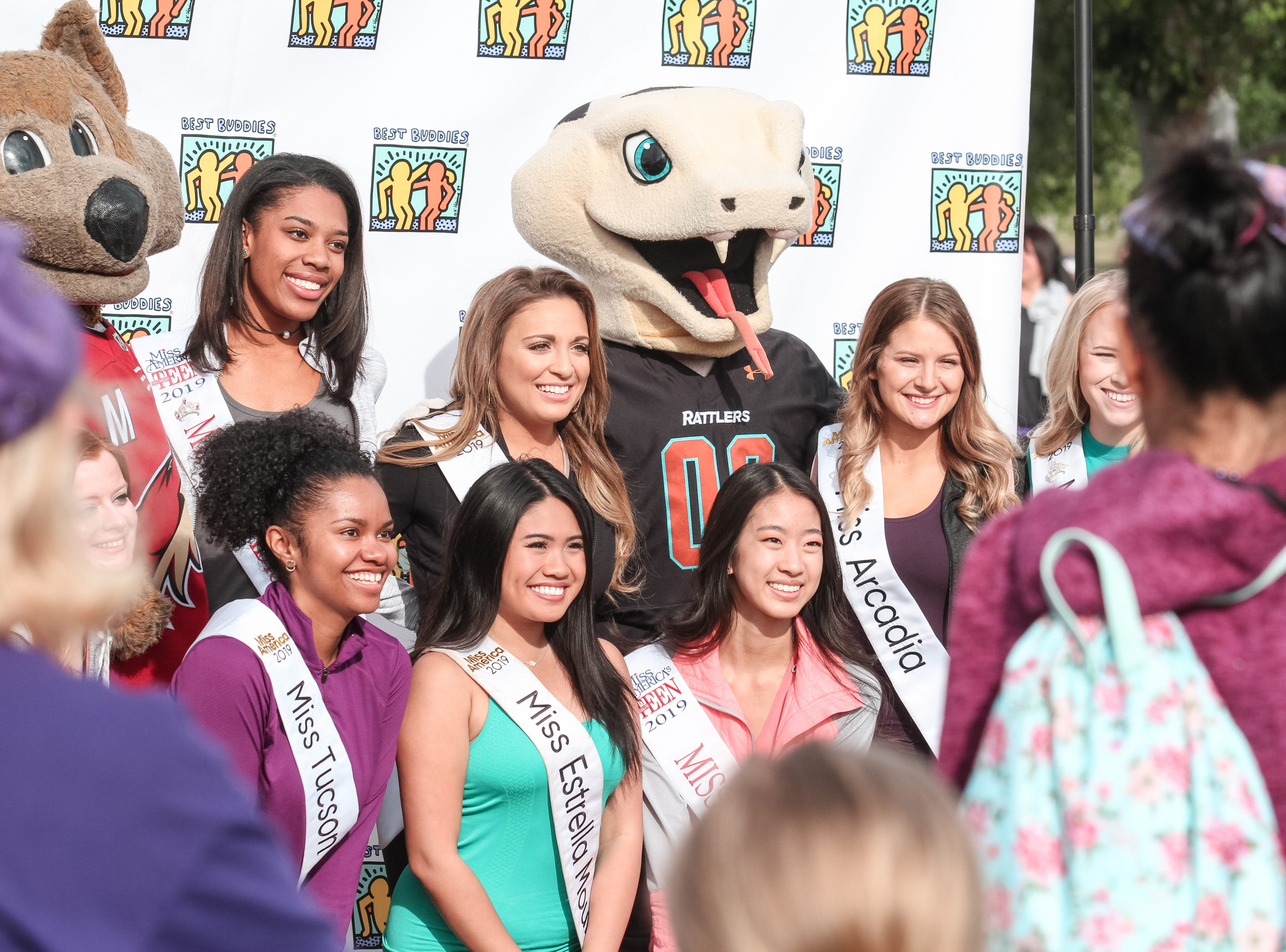 Beauty contestants pose for a photo at The Best Buddies Friendship Walk at Kiwanis Park in Tempe on March 23, 2019.
