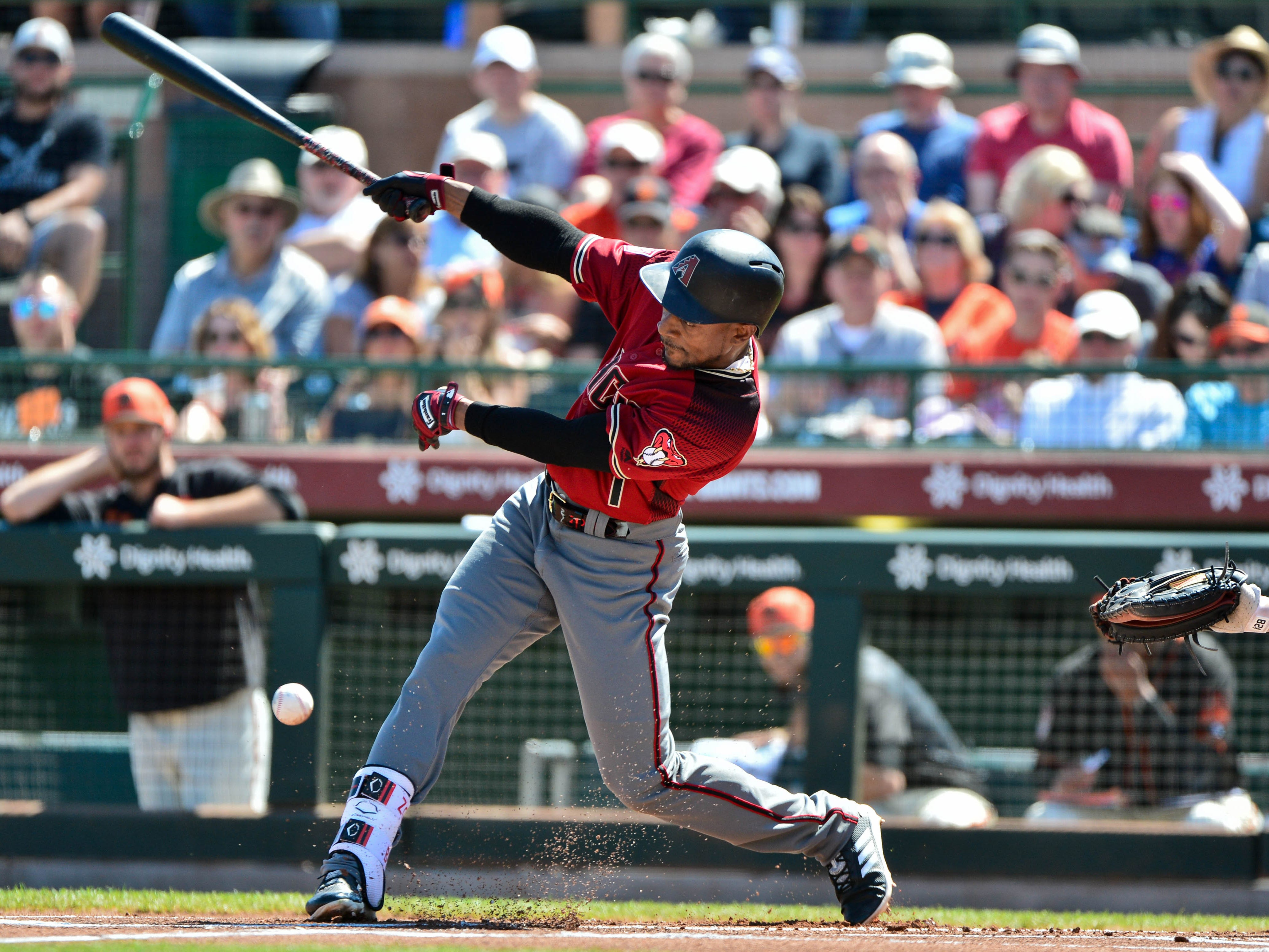 Mar 23, 2019; Scottsdale, AZ, USA; Arizona Diamondbacks center fielder Jarrod Dyson (1) doubles during the first inning against the San Francisco Giants at Scottsdale Stadium.