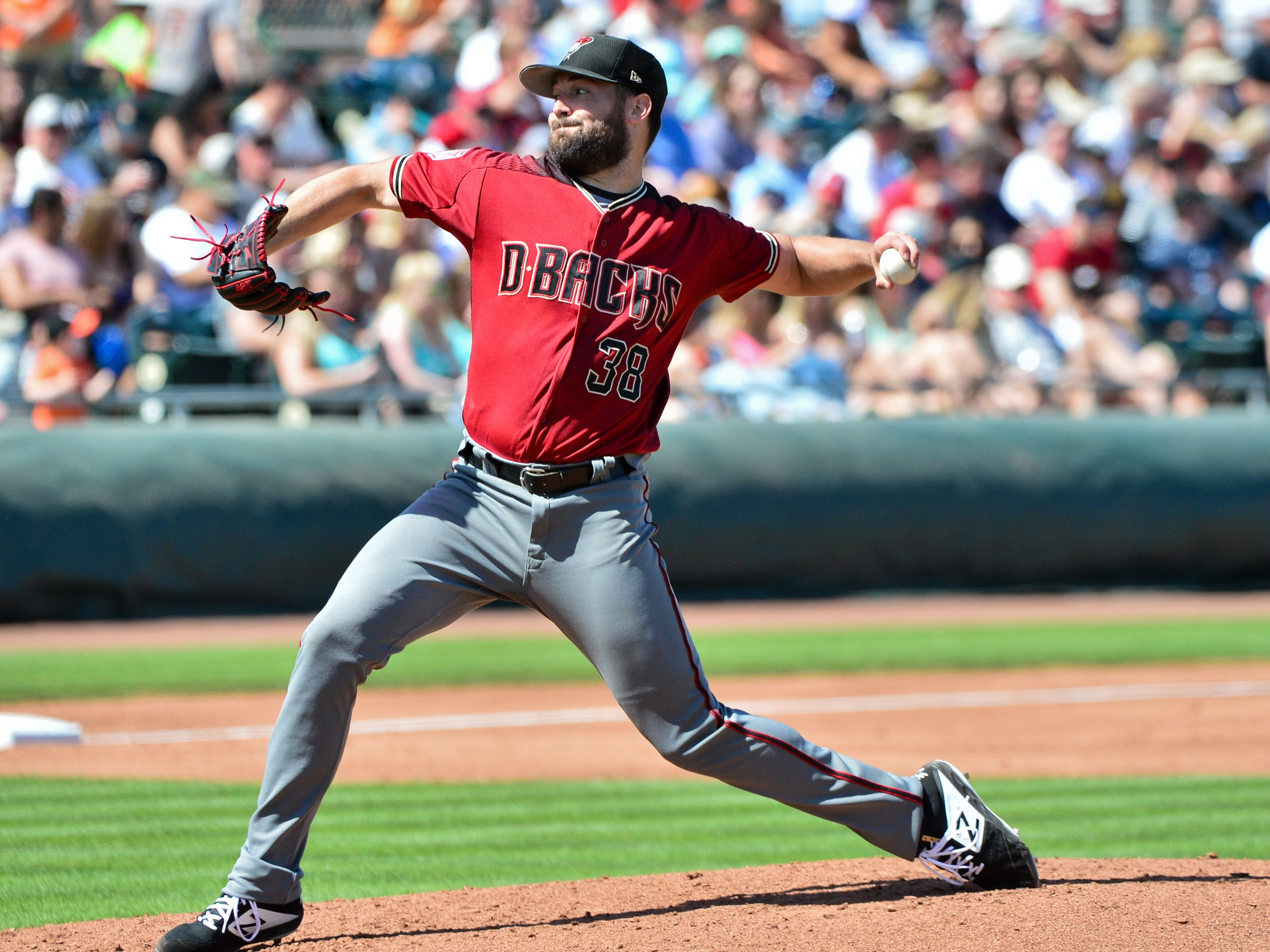 Mar 23, 2019; Scottsdale, AZ, USA; Arizona Diamondbacks starting pitcher Robbie Ray (38) throws during the third inning against the San Francisco Giants at Scottsdale Stadium.