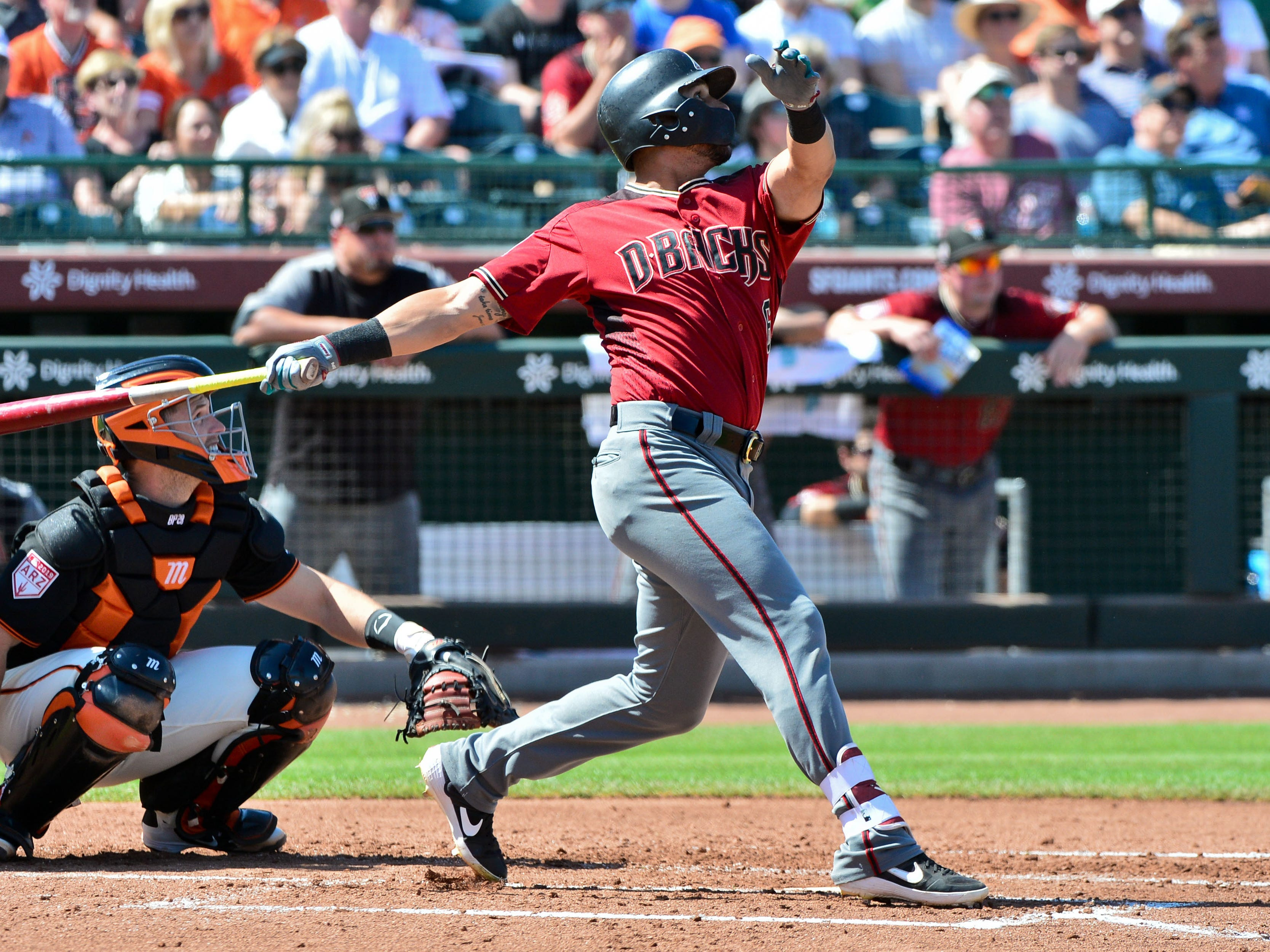 Mar 23, 2019; Scottsdale, AZ, USA; Arizona Diamondbacks right fielder David Peralta (6) hits a solo home run in the third inning against the San Francisco Giants at Scottsdale Stadium.
