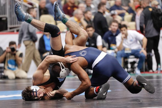 Penn State'a Mark Hall, right, lifts North Carolina's Devin Kane in their 174 lb. match in the first round of the NCAA wrestling championship, Thursday, March 21, 2019, in Pittsburgh. (AP Photo/Keith Srakocic)