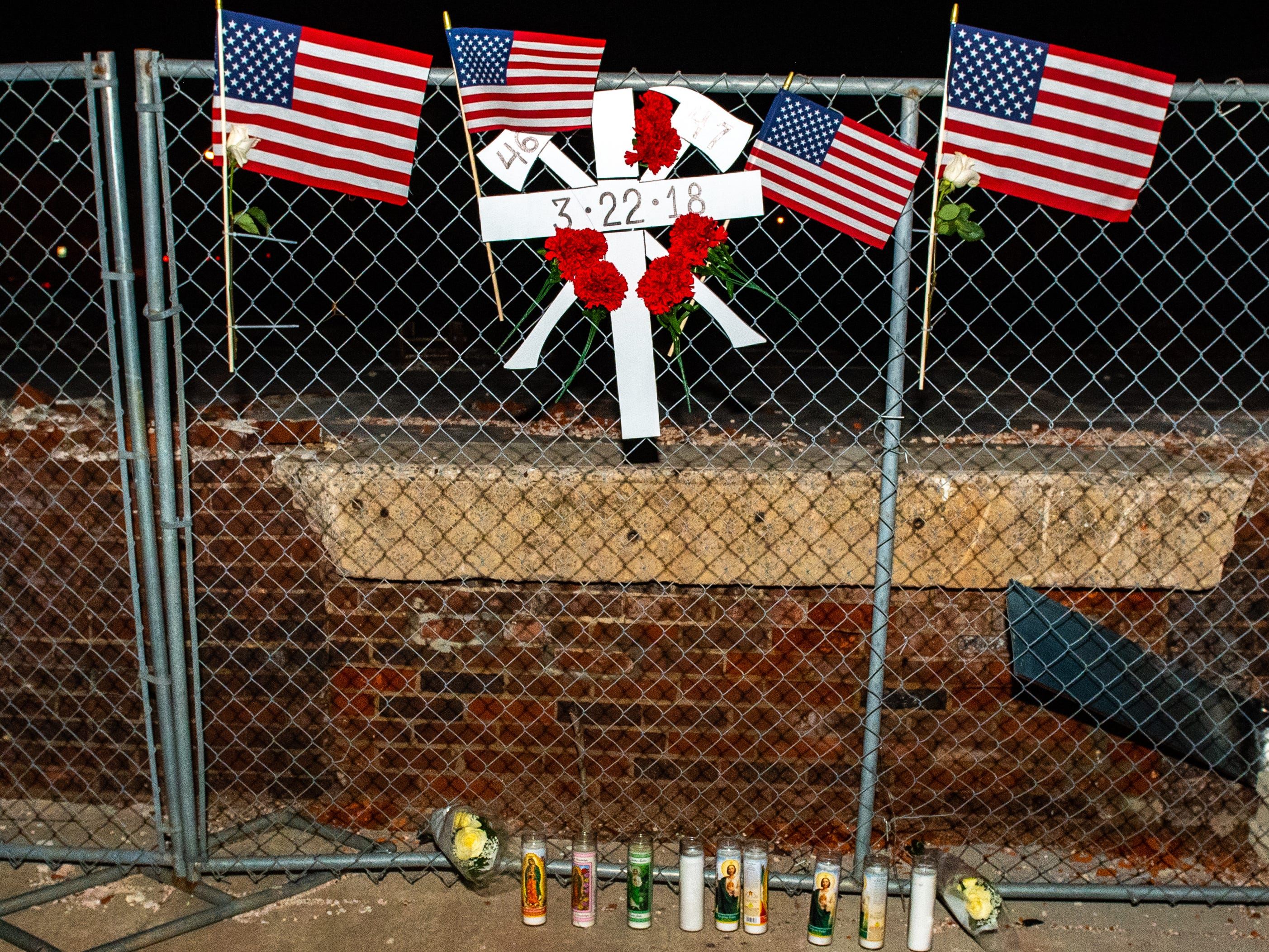 A memorial for firefighters Ivan Flanscha and Zachary Anthony is set up at the site where the Weaver building collapsed.