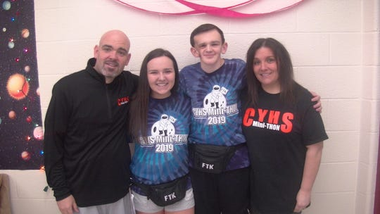 Central York senior Tucker Haas (middle right) stands with his father, Chad, younger sister, Taylor, and mother, Lisa, at Central York's mini-THON Saturday. A caner survivor, Tucker participated in his final mini-THON as a student this weekend.