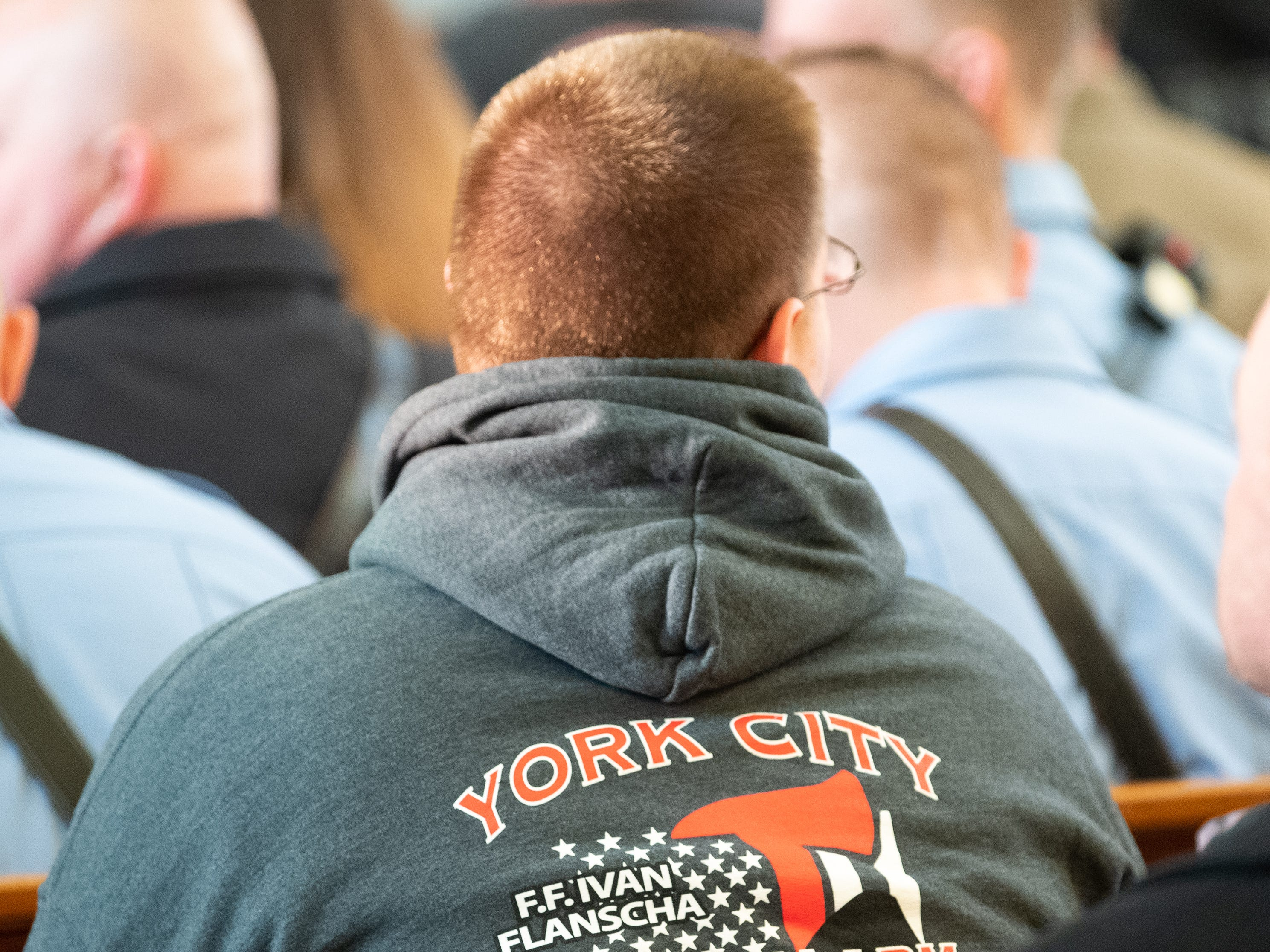 Some York City firefighters wore custom made sweatshirts honoring their fallen brothers, March 22, 2019.