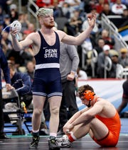 Penn State's Bo Nickal, left, celebrates after pinning Princeton's Patrick Bricki in their 197 pound match in the semifinals of the NCAA wrestling championships, Friday, March 22, 2019, in Pittsburgh. Nickal faces Ohio State's Kollin Moore in the finals Saturday.(AP Photo/Keith Srakocic)
