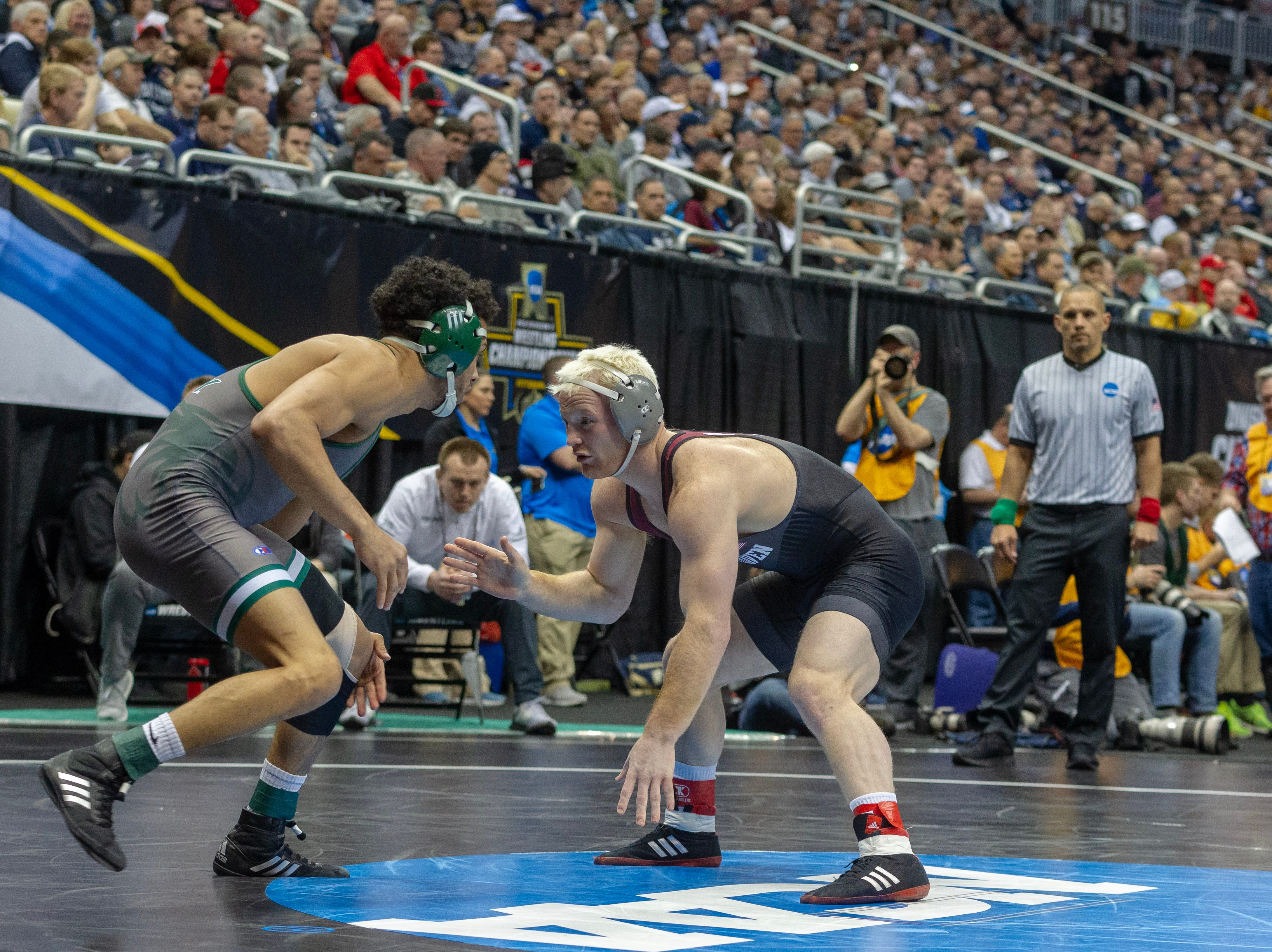 Chance Marsteller, right, pulled away from Demetrius Romero in the third period of his consolation match at the NCAA Championships. The Kennard-Dale grad scored a major decision.