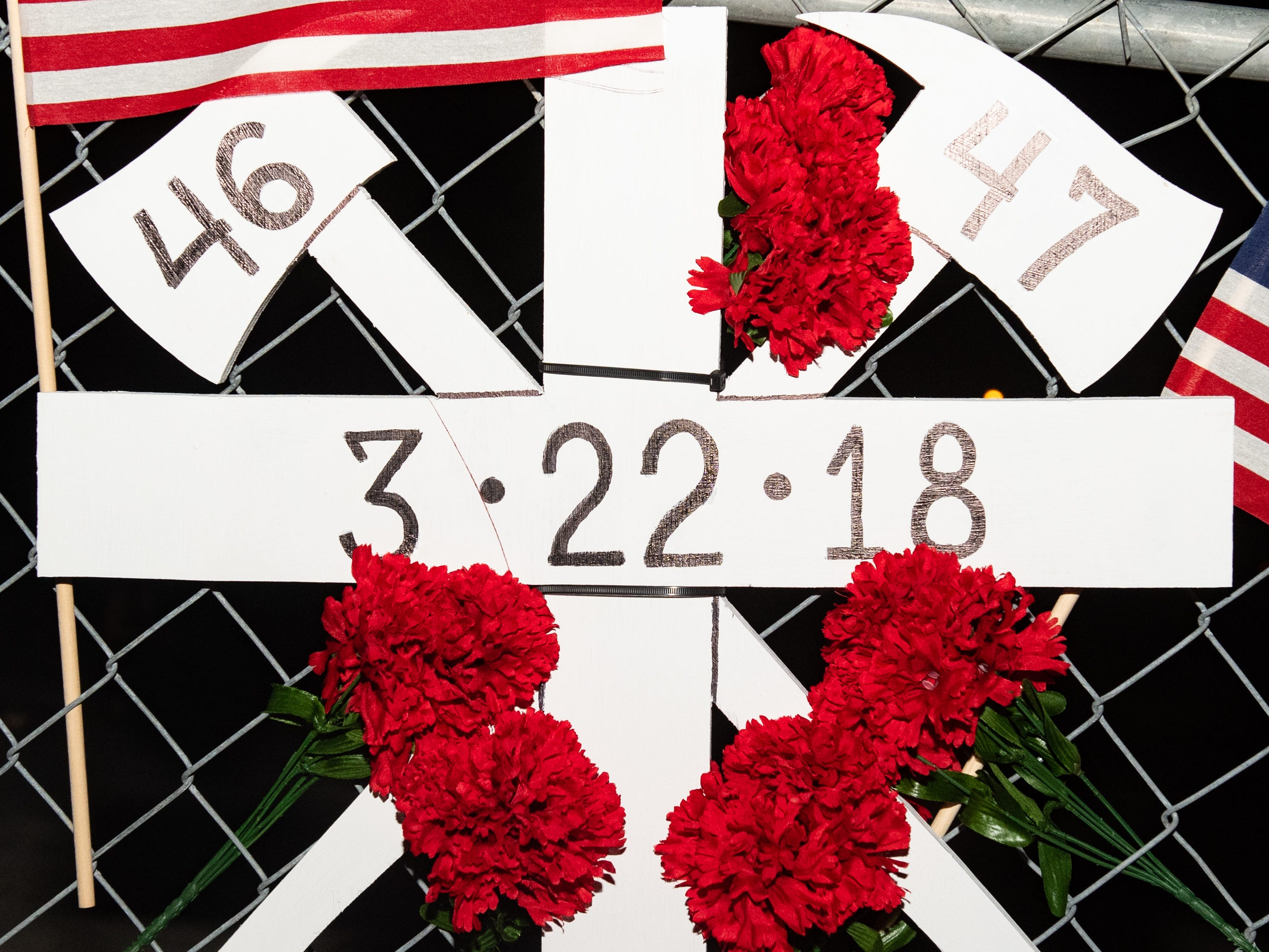 Each firefighters' number, along with the date of their death, is written on the handcrafted memorial, March 22, 2019.