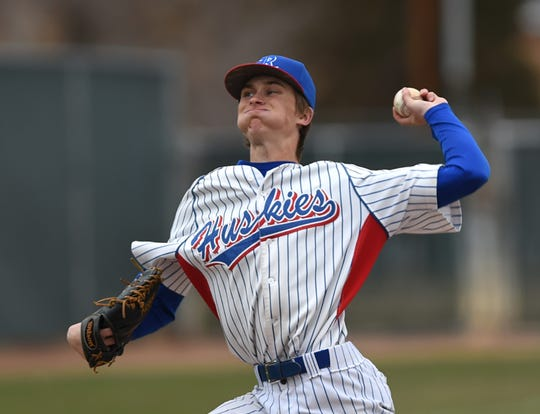 Reno's John Barry pitches against Douglas at Reno High School on March 19.