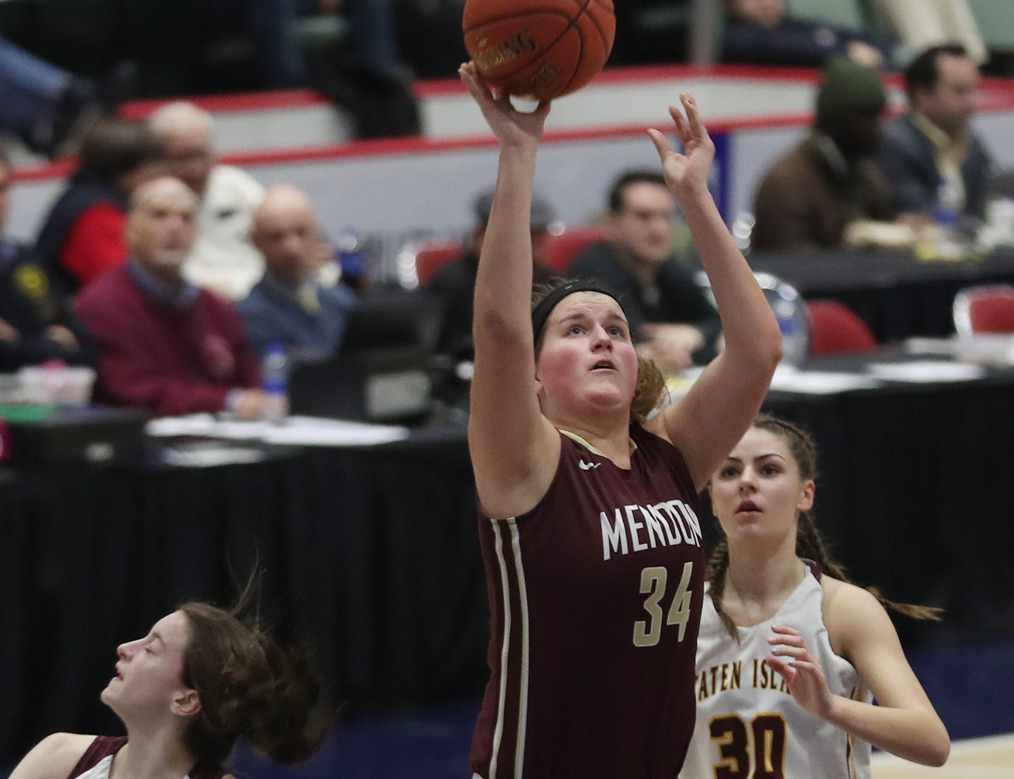 Pittsford Mendon's Maddy Mike (34) goes up for a shot against Staten Island in the championship game of the Federation Tournament at the Cool Insuring Arena in Glens Falls March 23, 2019.
