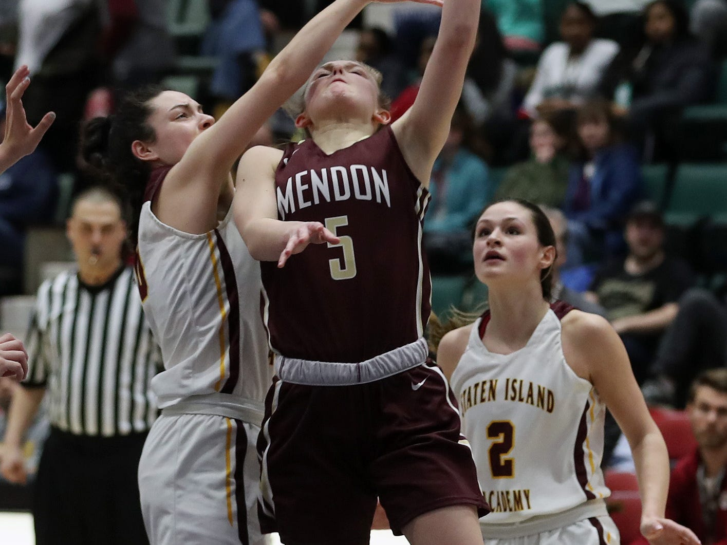 Pittsford Mendon's Courtney Naugle (5) goes up for a shot against Staten Island in the championship game of the Federation Tournament at the Cool Insuring Arena in Glens Falls March 23, 2019.