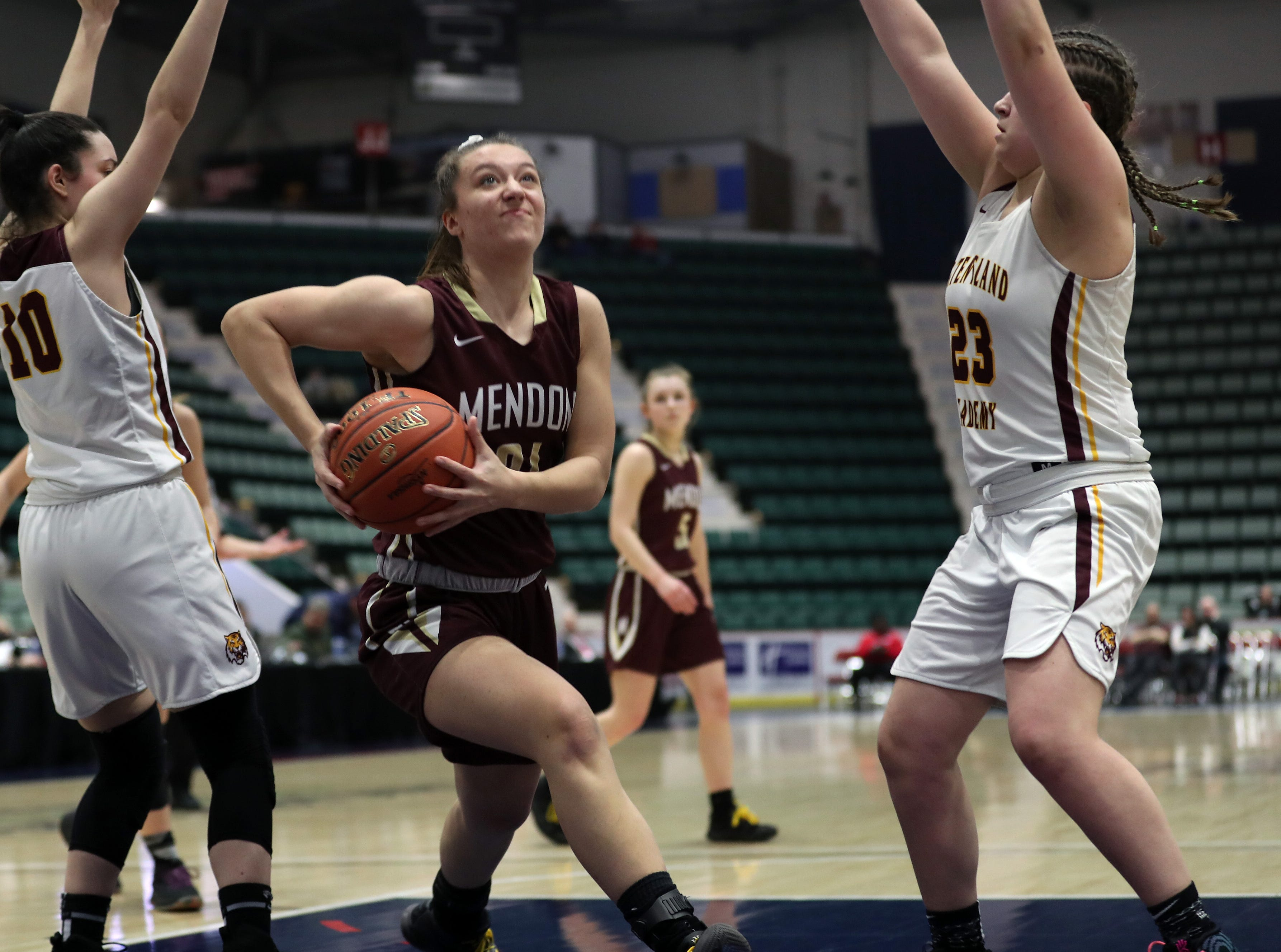 Pittsford Mendon's Alana Fursman (21) drives to the basket against Staten Island in the championship game of the Federation Tournament at the Cool Insuring Arena in Glens Falls March 23, 2019.