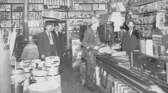 Lauterbach's Hardware in 1911, postcard. The man behind the counter is William Lauterbach, who founded the store in 1899.