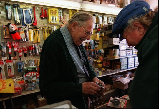 George Hamann, right, a close friend of Bill Lauterbach, left, at Lauterbach's Servistar Hardware on South Avenue, tries to match up a bathtub outlet from a very old tub.