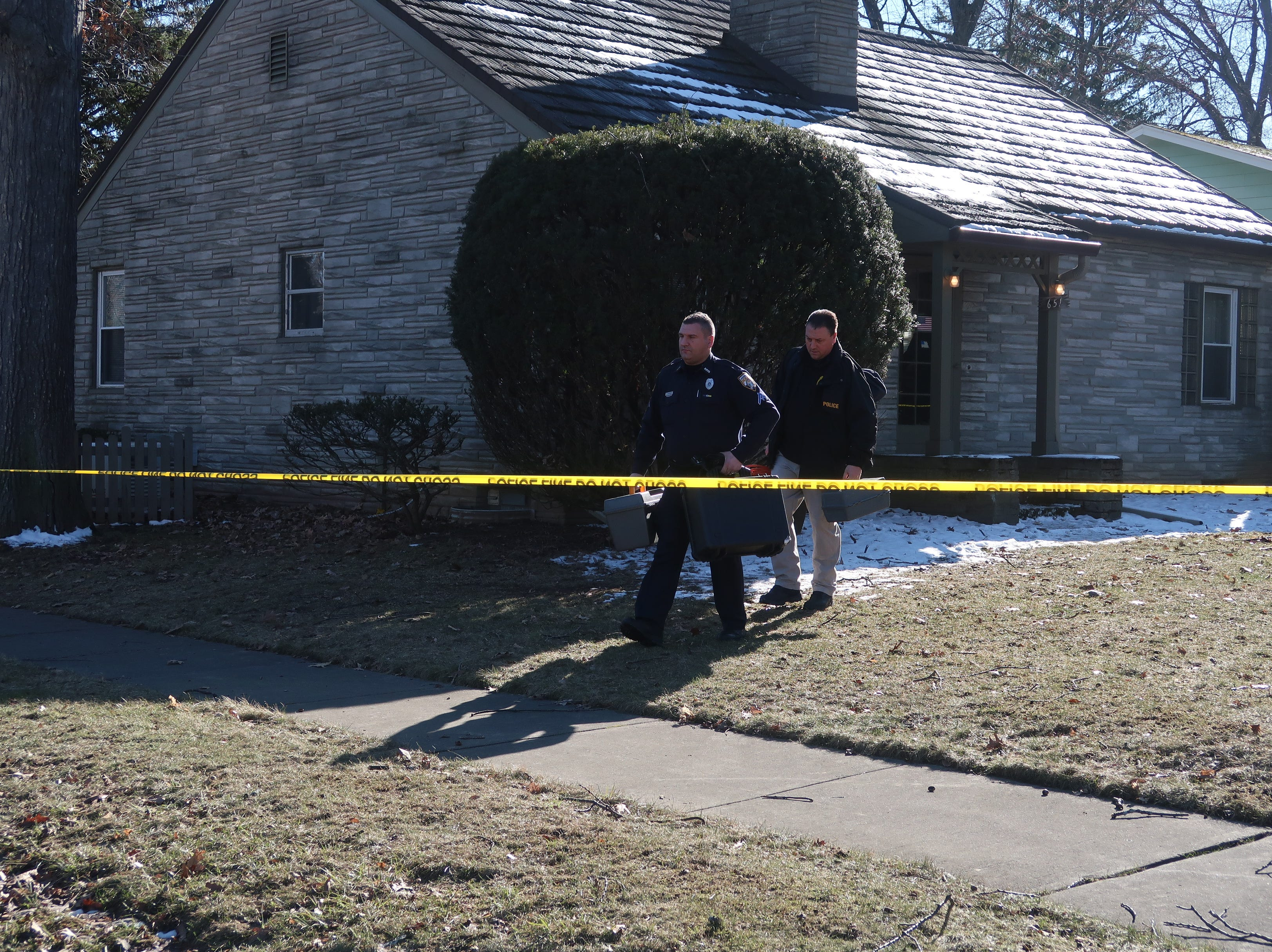Irondequoit police officers leaving the scene of a suspicious death on Lakeshore Boulevard Saturday.