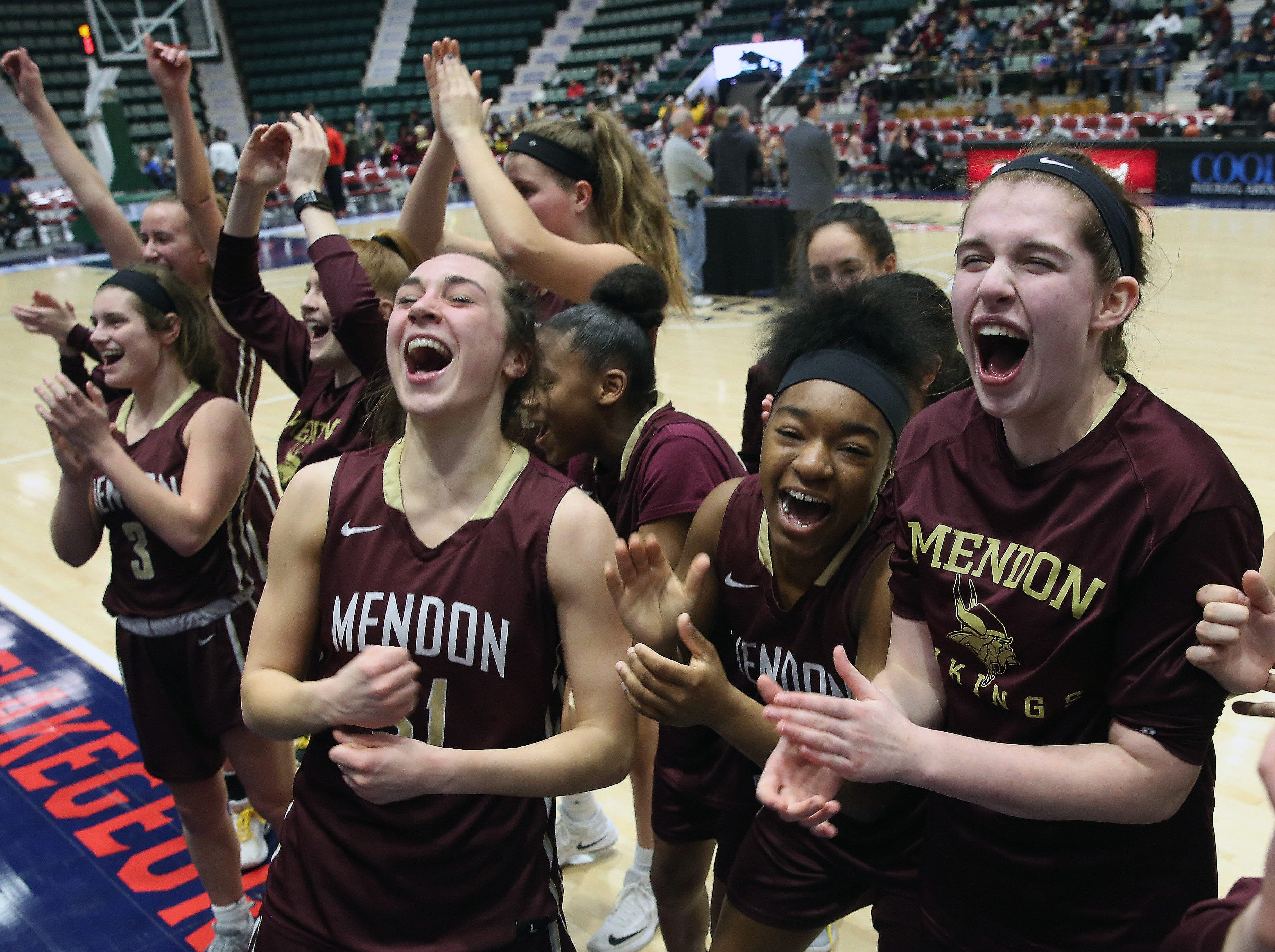 Pittsford Mendon players celebrate their victory over Staten Island in the championship game of the Federation Tournament at the Cool Insuring Arena in Glens Falls March 23, 2019.