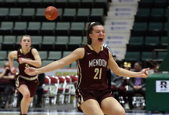 Pittsford Mendon's Alana Fursman (21) celebrates as time expires against Staten Island in the championship game of the Federation Tournament at the Cool Insuring Arena in Glens Falls March 23, 2019.