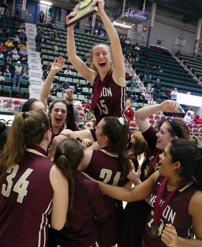 Pittsford Mendon players hold up teammate Danielle Strauf as they celebrate their victory over Staten Island in the championship game of the Federation Tournament at the Cool Insuring Arena in Glens Falls March 23, 2019.