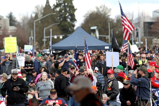 Thousands attend the Defend the 2nd Rally, in response to firearm-related bills proposed in the Oregon Legislature, outside the Oregon State Capitol in Salem on March 23, 2019.