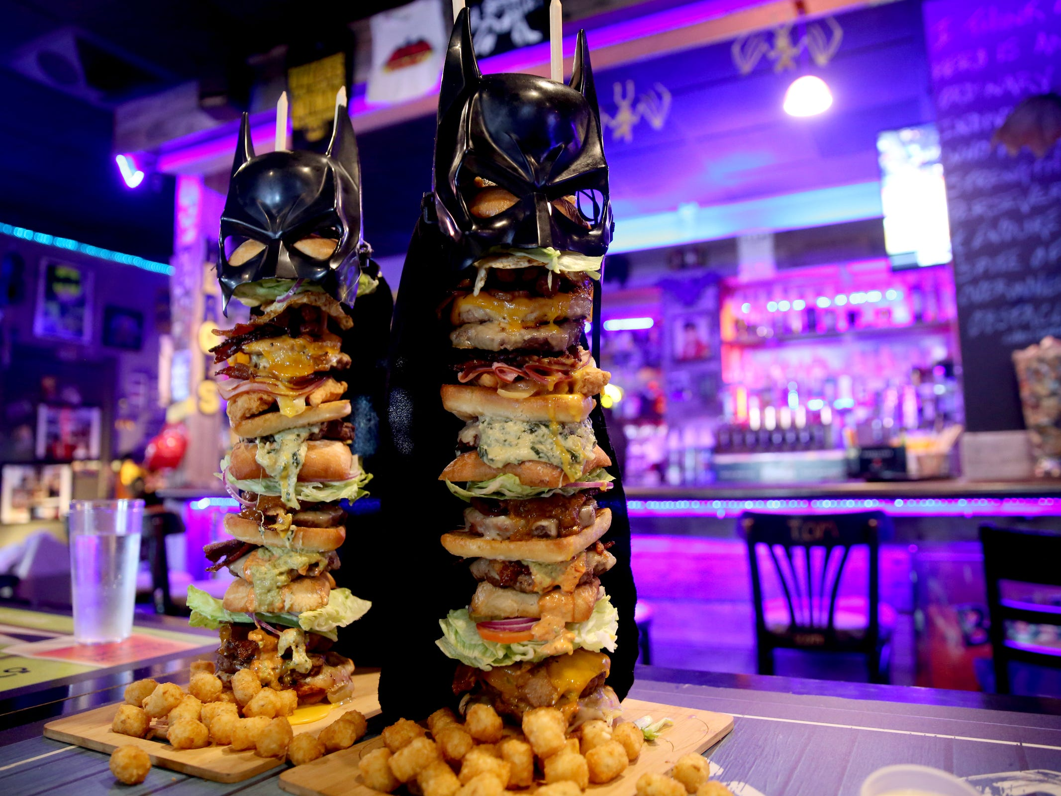 "The stacks are ready for a Statesman Journal eating challenge against professional competitive eater ""Max Carnage"" to finish the Dark Knight Burger, consisting of six top-selling burgers, at Heroes Tap House in Salem on March 22, 2019. The Statesman Journal crew finished the stack in 35 minutes."