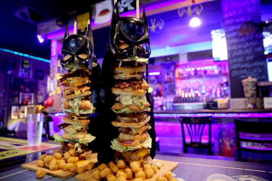 The Dark Knight Burger, consisting of six top-selling burgers, eating challenge photographed at Heroes Tap House in Salem on March 22, 2019.