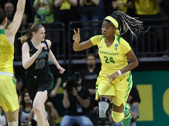 Oregon's Ruthy Hebard, right, gestures to her teammates after scoring against Portland State during the first half of a first-round game of the NCAA women's college basketball tournament Friday, March 22, 2019, in Eugene, Ore. (AP Photo/Chris Pietsch)