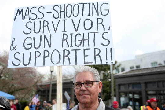 Tim Lesmeister, 62, of Salem, attends the Defend the 2nd Rally, in response to firearm-related bills proposed in the Oregon Legislature, outside the Oregon State Capitol in Salem on March 23, 2019. Lesmeister survived the Oregon Museum Tavern shooting of 1981 where four people were killed and 20 more injured.