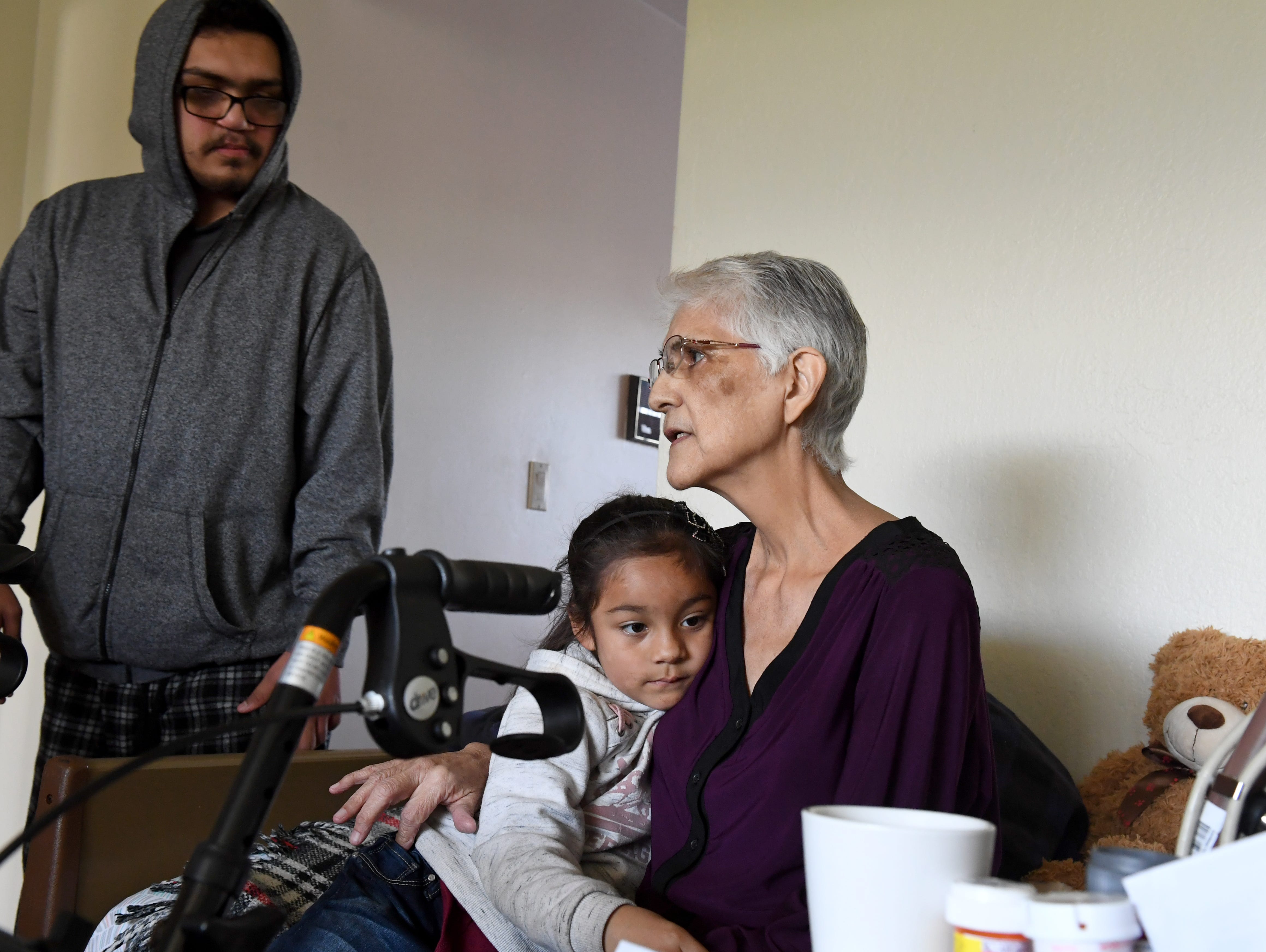 Gloria Torrez sits with her granddaughter Tiana at her Salinas home in March 2019.
