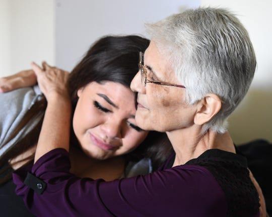Gloria Torrez abraza a su nieta y tocaya, Gloria, en su hogar en Salinas en marzo de 2019.