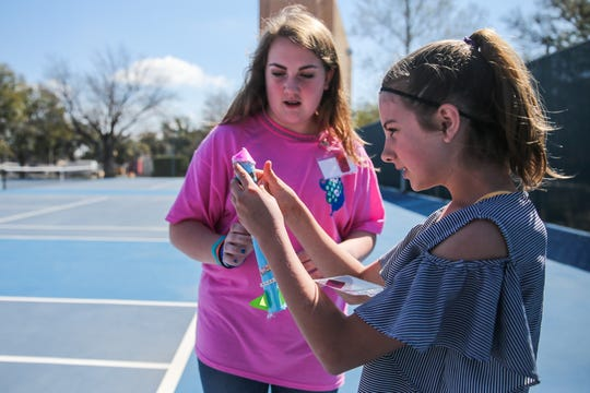 Maddax Thompson and Jaclynn Dankworth fix their rockets after the first launch during the Girl Scouts STEM conference Saturday, March 23, 2019, at Angelo State University.