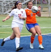 San Angelo Central's Averi Handy (5) fights for the ball against Euless Triniity in a District 3-6A girls soccer match at Old Bobcat Stadium, Friday, March 22, 2019.
