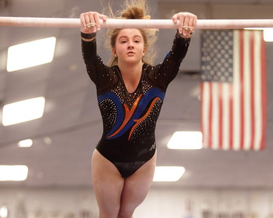 San Angelo Central's Savanna Razani competes on uneven bars during the District 2-6A Gymnastics Championships hosted by Central on Friday, March, 22, 2019.