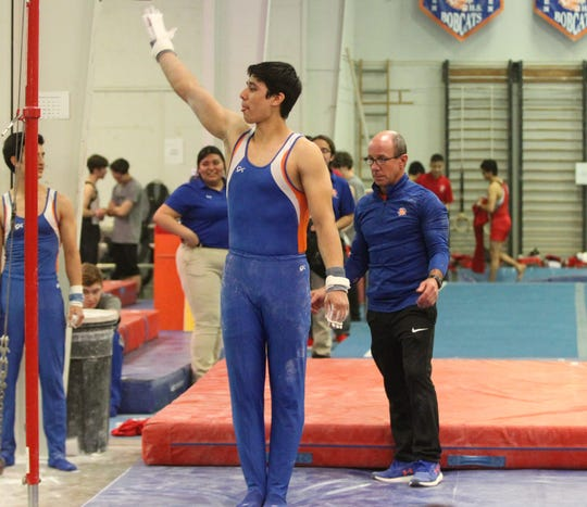 San Angelo Central's Mariano Deller looks for a high score on high bar during the District 2-6A Gymnastics Championships hosted by Central, Friday, March 22, 2019.