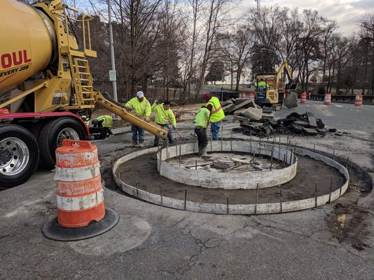 A construction crew works to renovate the intersection of South Park Drive and Memorial Plaza as part of an initiative to improve pedestrian safety in Salisbury.