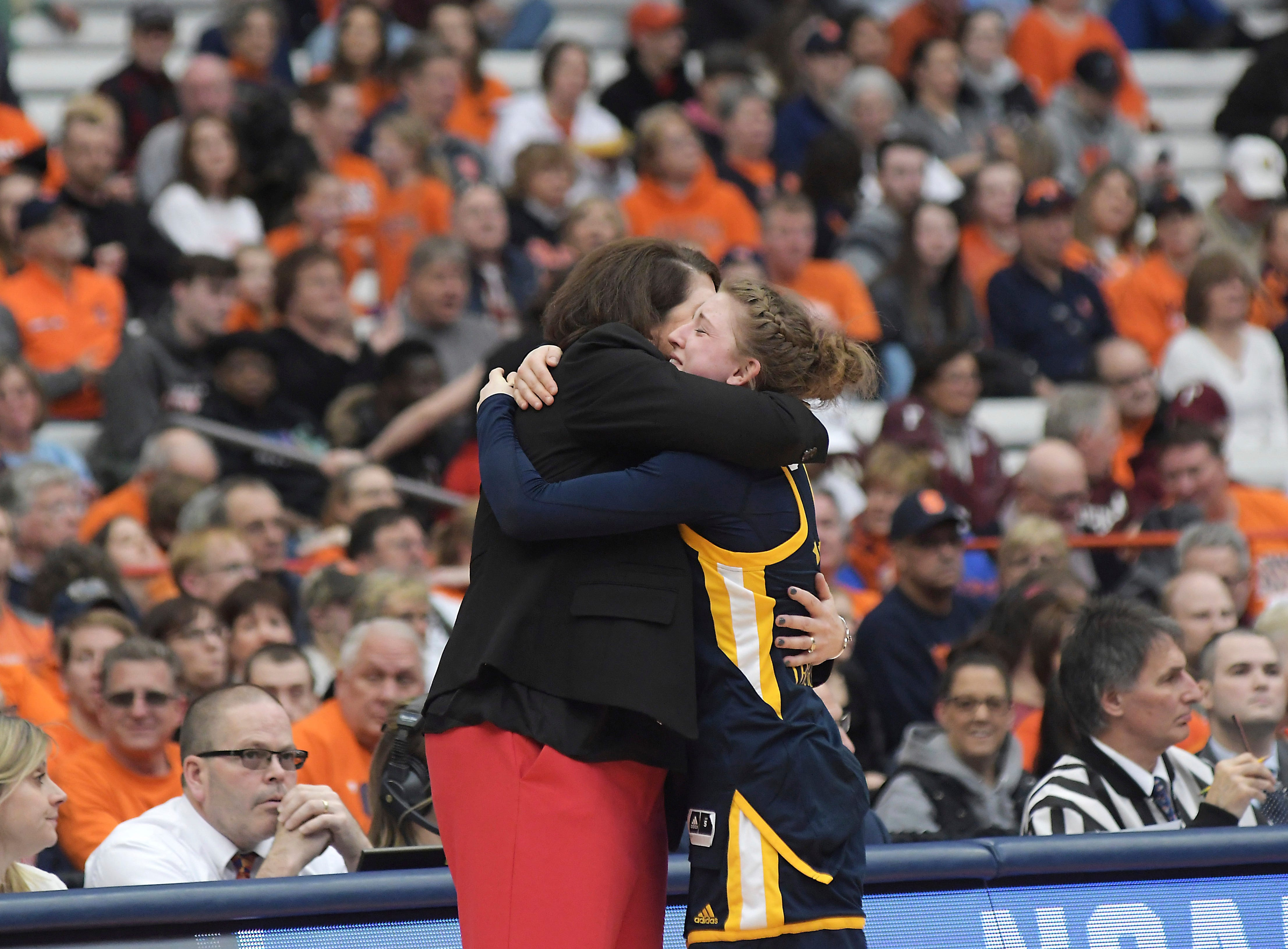 Quinnipiac head coach, Tricia Fabbri, left, hugs Edel Thornton after a first-round game against South Dakota State in the NCAA women's college basketball tournament in Syracuse, N.Y., Saturday, March 23, 2019. (AP Photo/Heather Ainsworth)