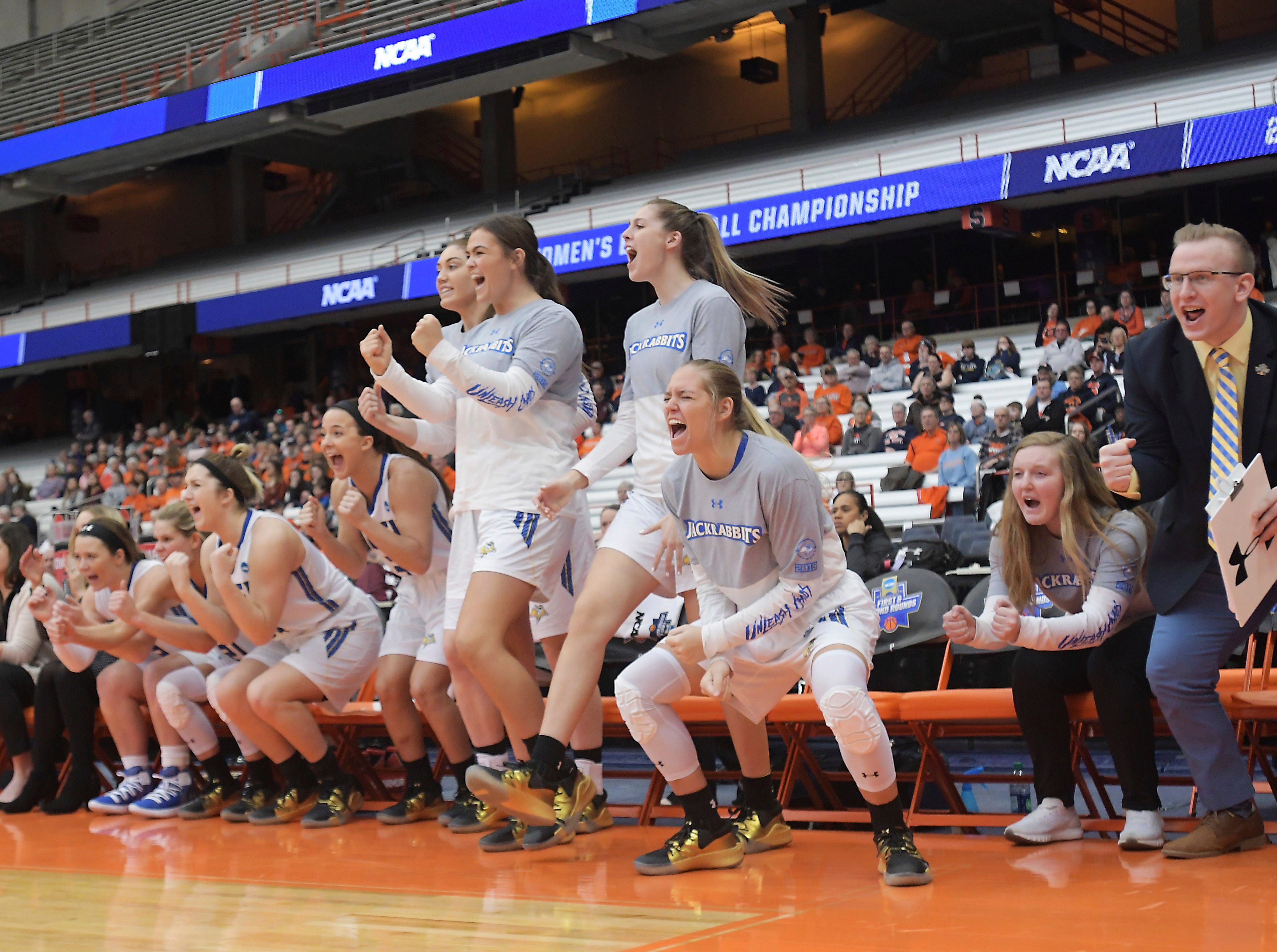 South Dakota State players get excited after a basket against Quinnipiac during a first-round game in the NCAA women's college basketball tournament in Syracuse, N.Y., Saturday, March 23, 2019. (AP Photo/Heather Ainsworth)