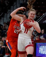 South Dakota guard Monica Arens (11) tries to fight off a steal by Clemson guard Simone Westbrook (20) during the second half of a first round women's college basketball game in the NCAA Tournament in Starkville, Miss., Friday, March 22, 2019. (AP Photo/Rogelio V. Solis)