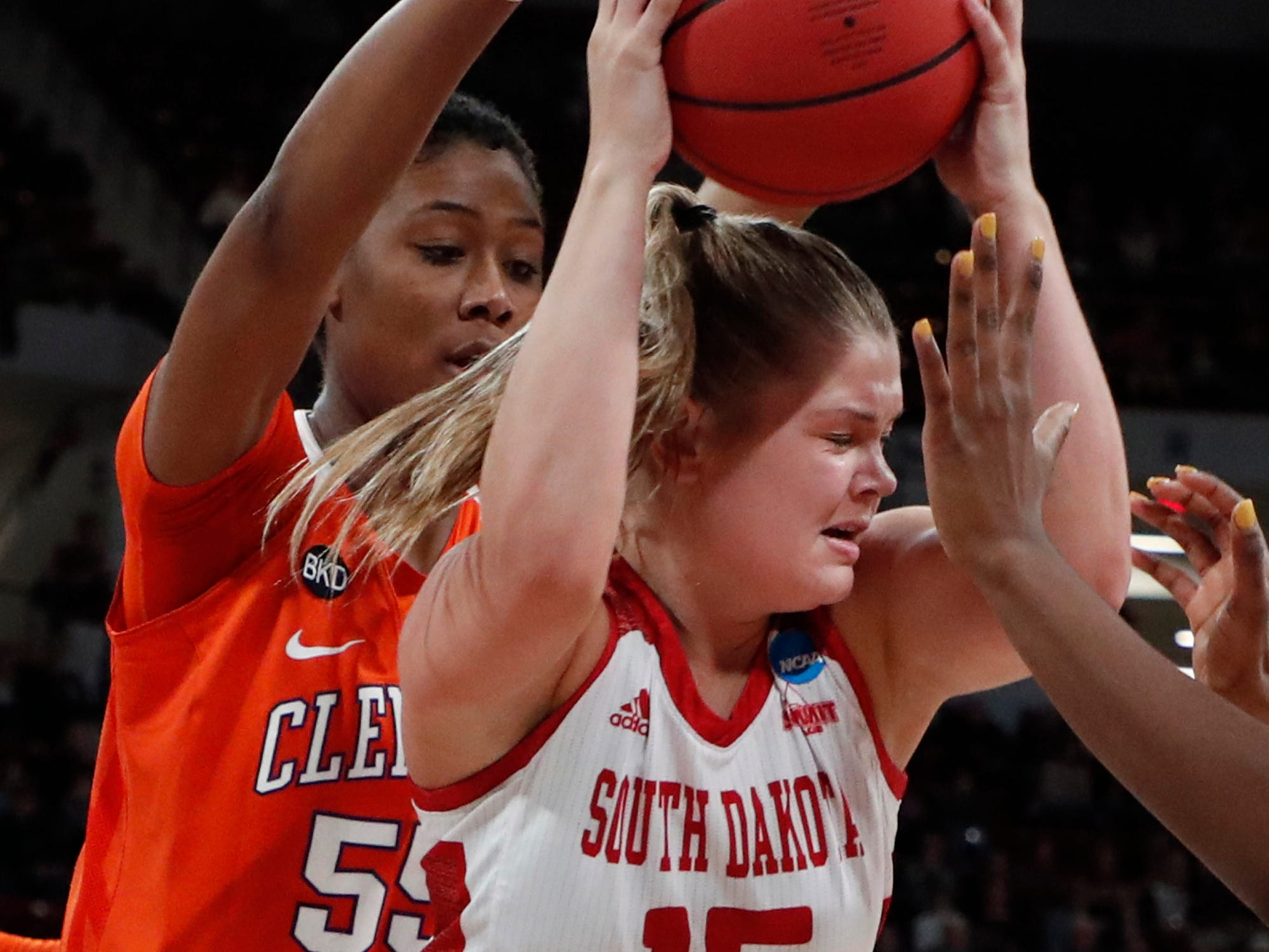 South Dakota forward Taylor Frederick (15) is trapped by Clemson forward Tylar Bennett (55) as she attempts to pass during the second half of a first round women's college basketball game in the NCAA Tournament in Starkville, Miss., Friday, March 22, 2019. (AP Photo/Rogelio V. Solis)