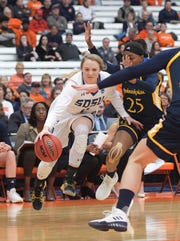South Dakota State's Madison Guebert (11) drives past Quinnipiac's Aryn McClure (25) during a first round of women's college basketball game in the NCAA Tournament in Syracuse, N.Y., Saturday, March 23, 2019. (AP Photo/Heather Ainsworth)