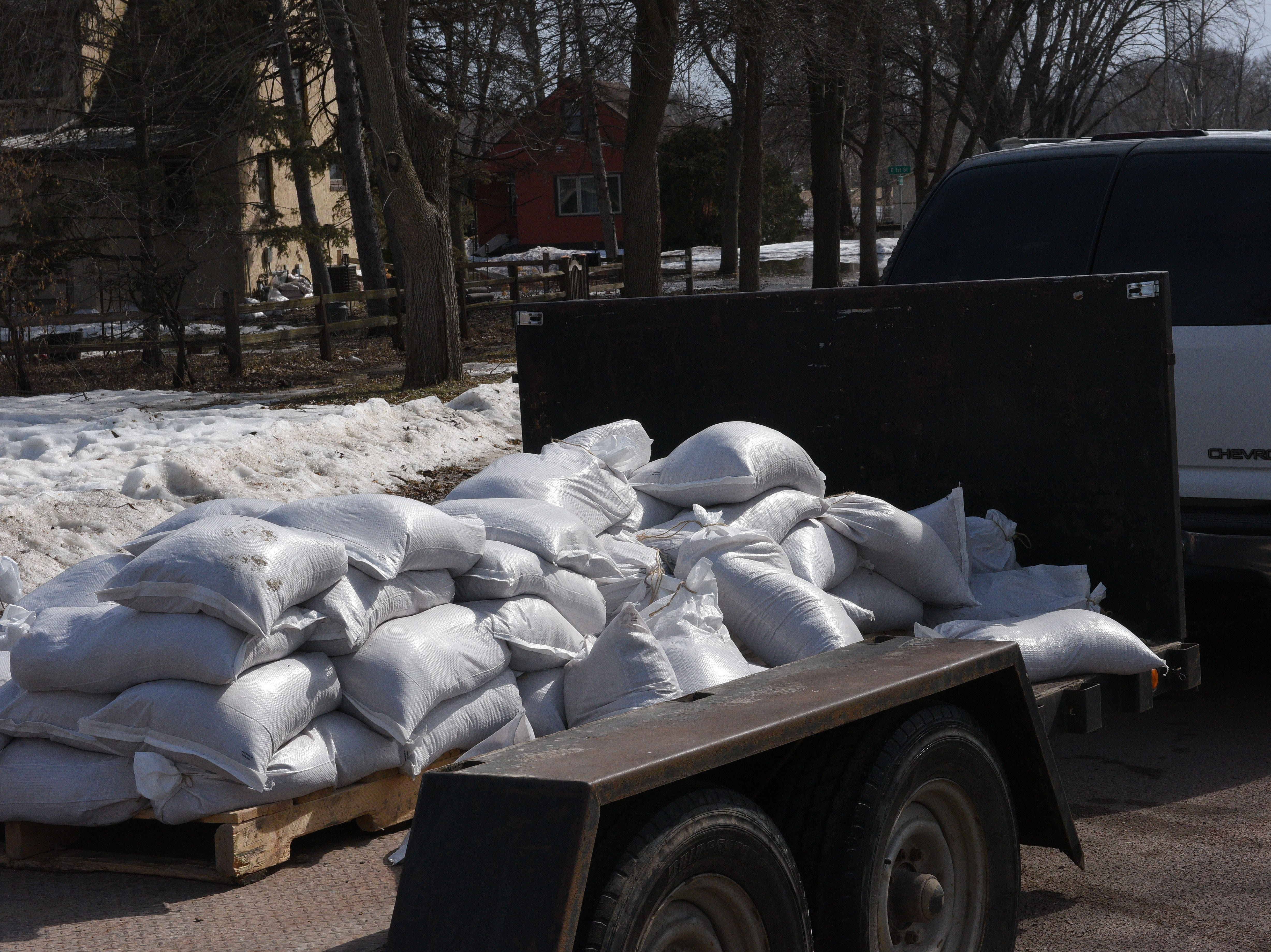 Sandbags are delivered to a house in Dell Rapids on March 23, 2019. Significant flooding is expected around the city following near-record river flows.