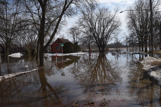 Water from the Big Sioux River slowly floods an intersection in Dell Rapids on March 23, 2019. Significant flooding is expected around the city following near-record river flows.