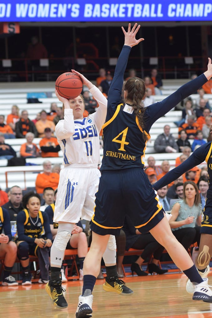 South Dakota State's Madison Guebert (11) shoots over Quinnipiac's Paula Strautmane during of a first-round game in the NCAA women's college basketball tournament in Syracuse, N.Y., Saturday, March 23, 2019. South Dakota State won 76-65. (AP Photo/Heather Ainsworth)