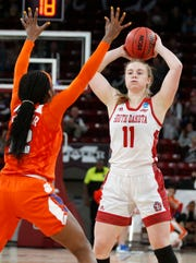 South Dakota guard Monica Arens (11) looks for an open teammate while Clemson guard Aliyah Collier (12) defends during the second half of a first round women's college basketball game in the NCAA Tournament in Starkville, Miss., Friday, March 22, 2019. (AP Photo/Rogelio V. Solis)