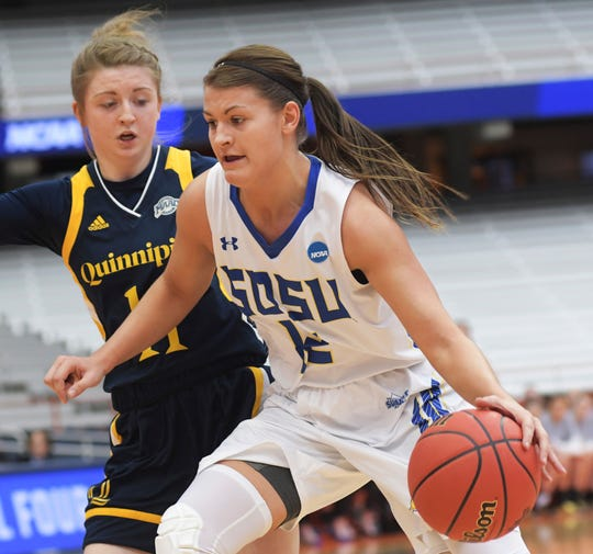 South Dakota State's Macy Miller (12) dives past Quinnipiac's Edel Thornton during of a first-round game in the NCAA women's college basketball tournament in Syracuse, N.Y., Saturday, March 23, 2019. South Dakota State won 76-65. (AP Photo/Heather Ainsworth)