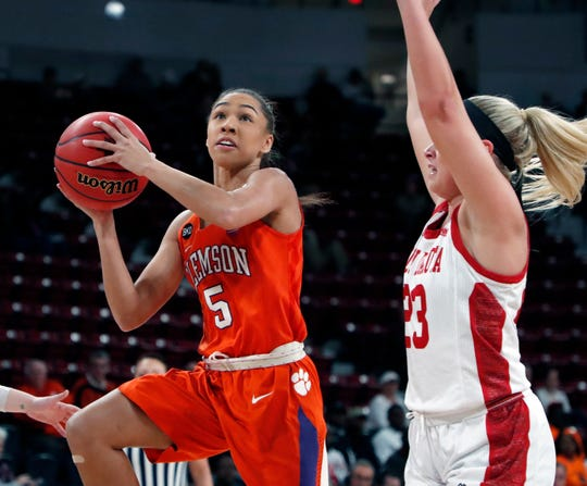Clemson guard Danielle Edwards (5) attempts a layup while South Dakota guard Madison McKeever (23) defends during a first round women's college basketball game in the NCAA Tournament in Starkville, Miss., Friday, March 22, 2019. (AP Photo/Rogelio V. Solis)